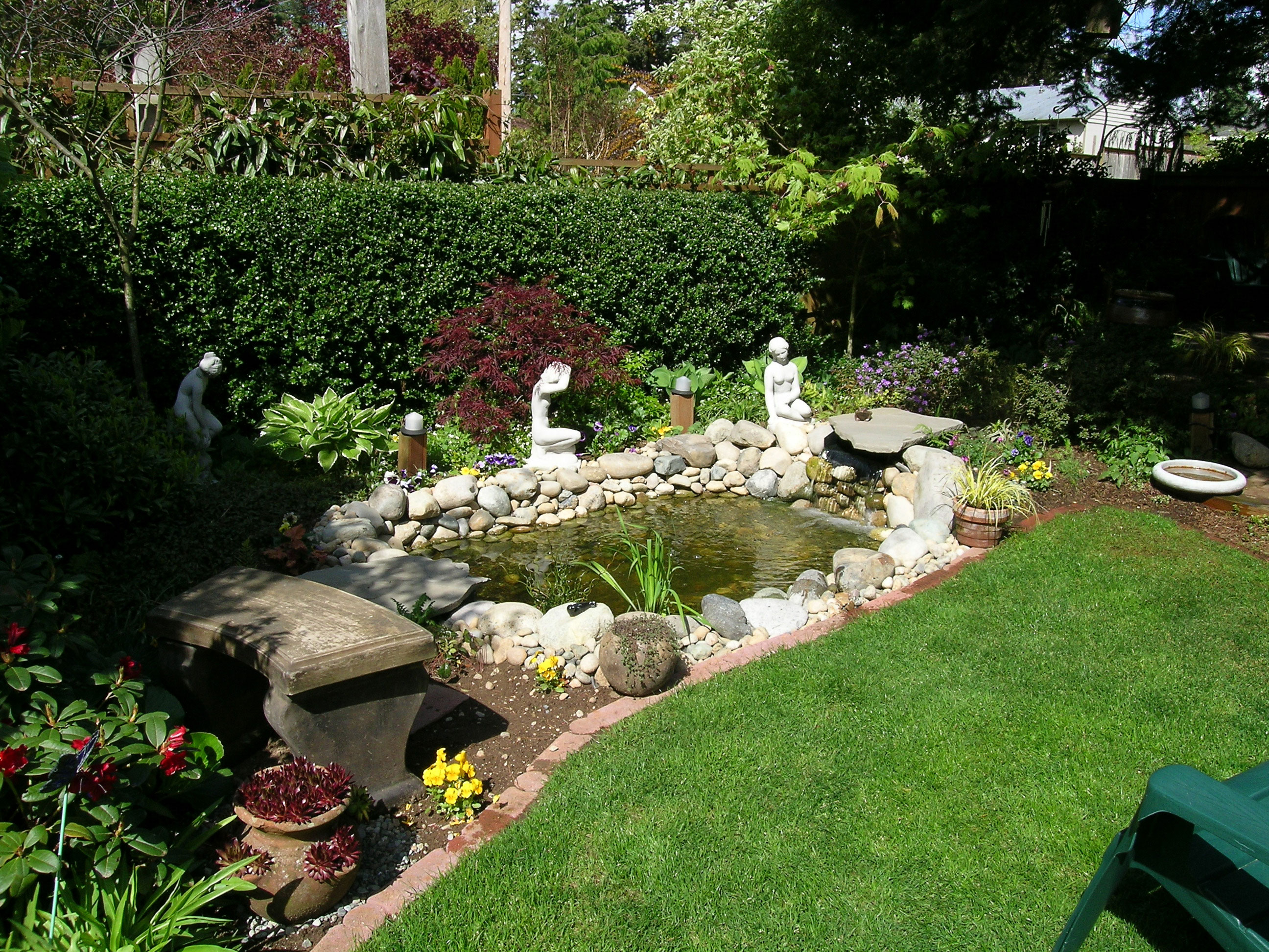 Backyard Pond designed with Do It Yourself Landscaping